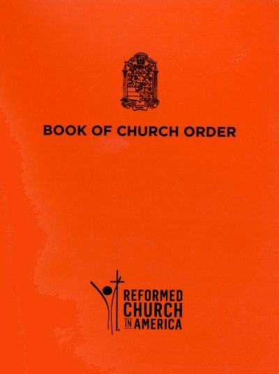 The RCA's Book of Church Order features an orange cover and the RCA crest.