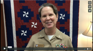 Female service chaplain at podium